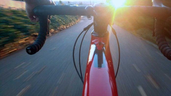 biking at sunrise or sunset from handlebars