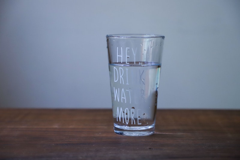Glass with message to drink more water