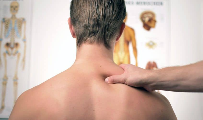 physical therapy on man shoulder